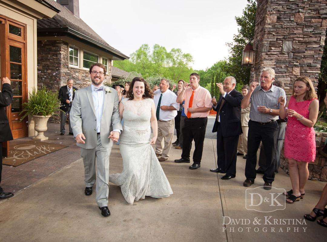 bride and groom leaving their wedding reception at the Cliffs Glassy Mountain Clubhouse