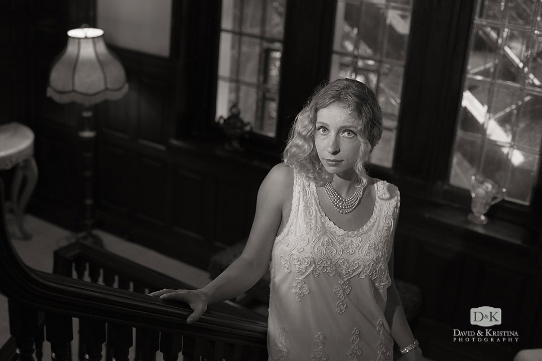 Bride standing on stairway at Gassaway Mansion