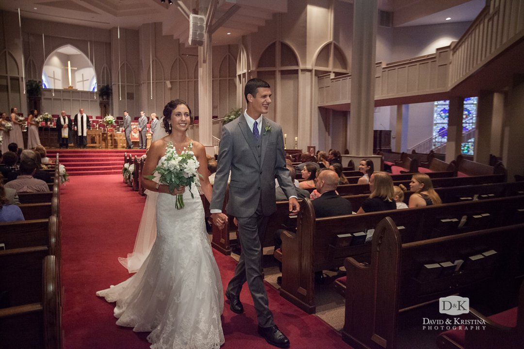 bride and groom walk up the aisle as husband and wife Easley First Baptist wedding