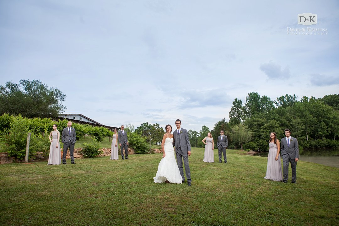 Greenbrier Farms wedding party in front of barn and vineyards