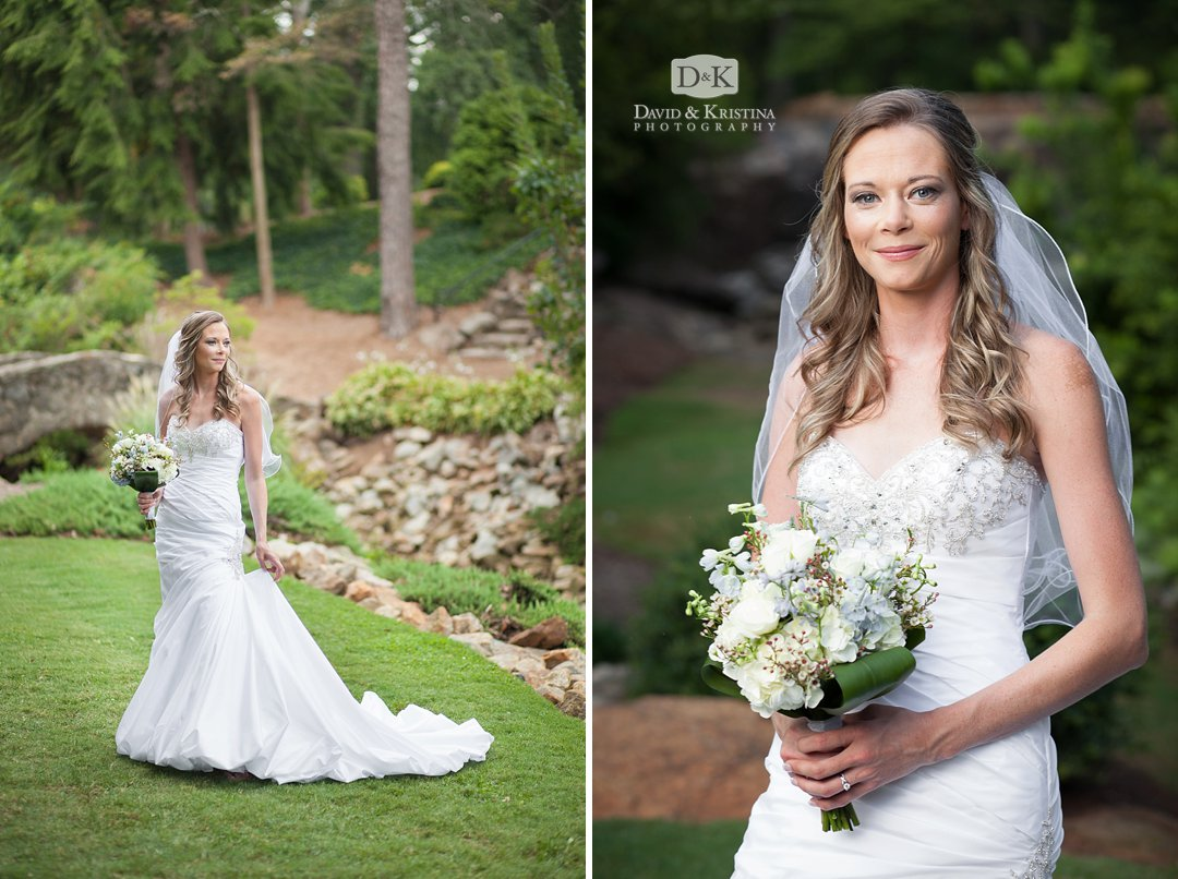 bridal portrait with bouquet and veil in front of stone bridge