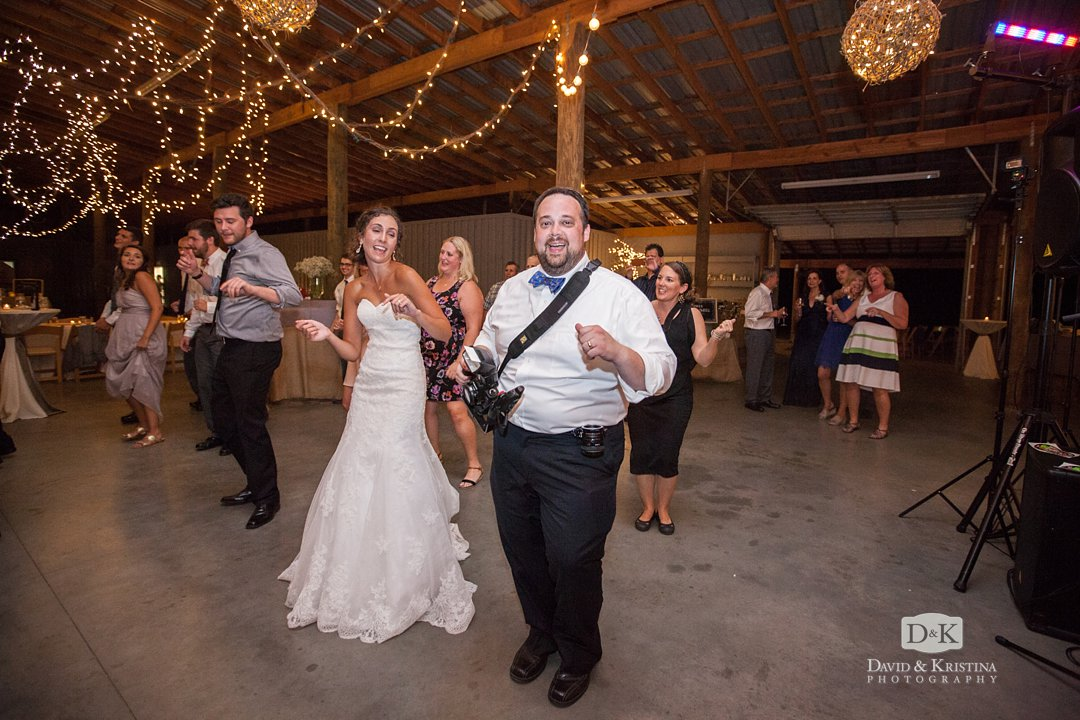 photographers dancing during wedding reception