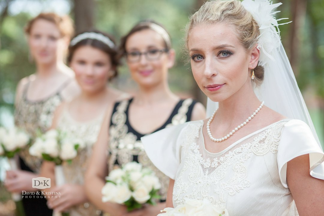 Bride with bridesmaids in the background