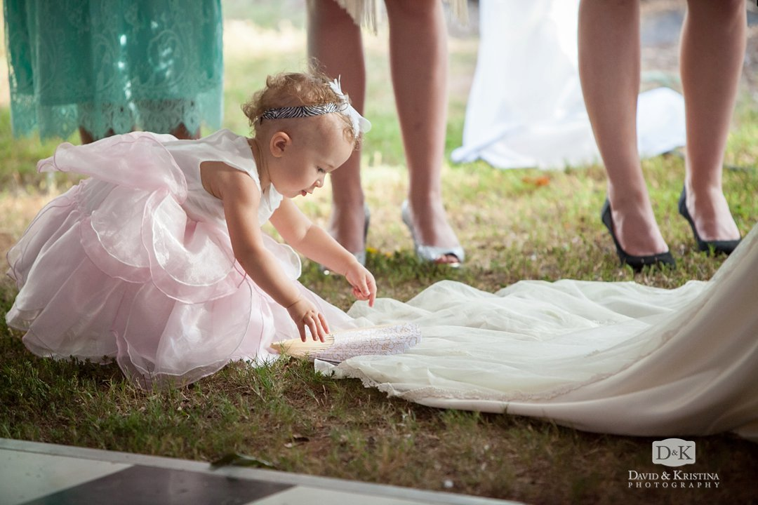 baby plays with bride's dress