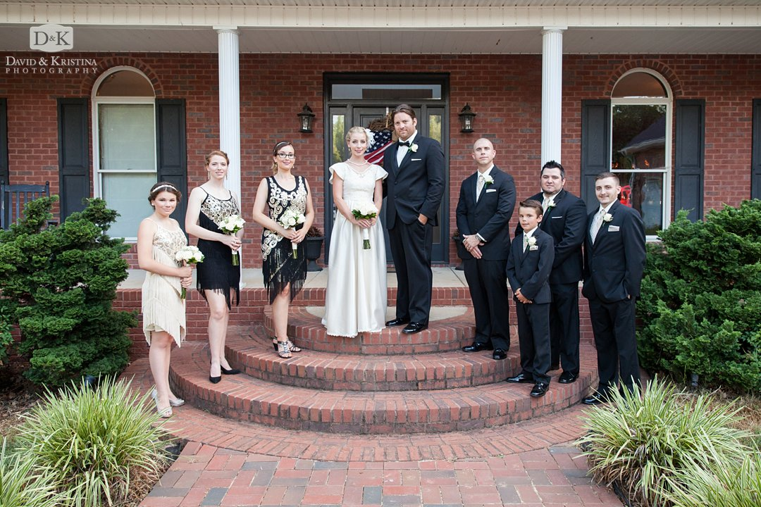 wedding party on front steps of lake house