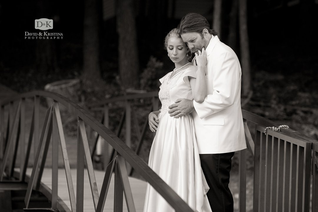 Bride and groom on dock at Hartwell lake