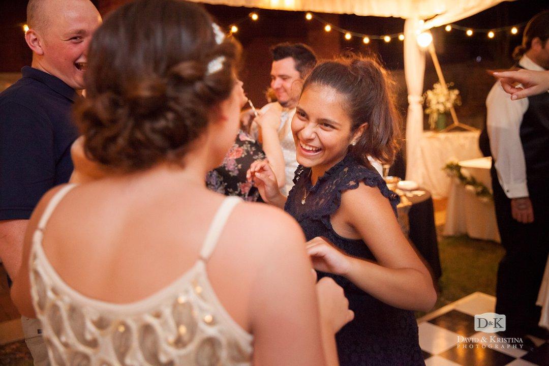 Dancing at backyard wedding reception at lake house
