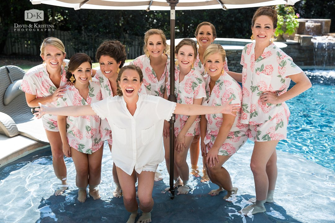 bridesmaids standing in pool with pajamas on