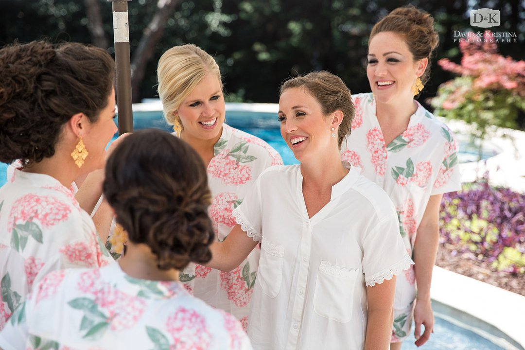 bride hanging out with bridesmaids at pool