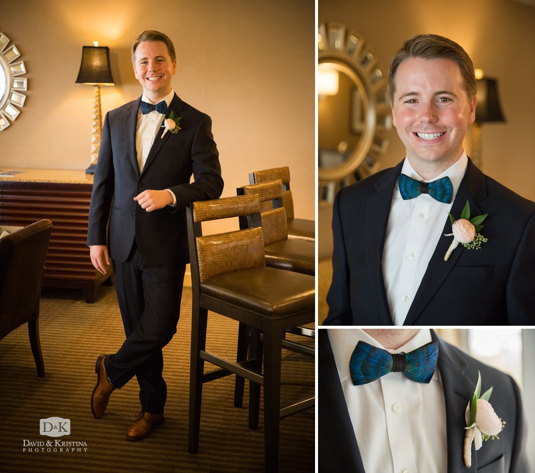 groom wearing blue peacock feather bowtie