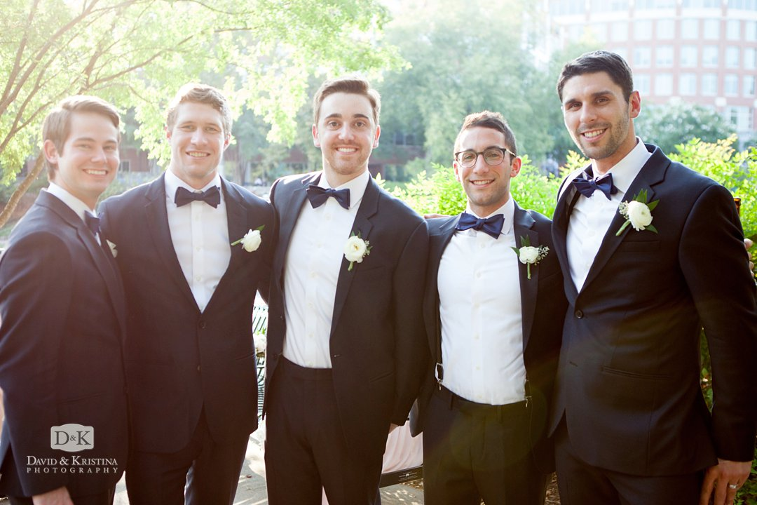 groomsmen hanging out during photo time