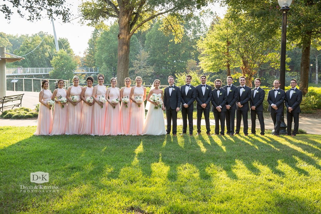 large bridal party photo at Liberty Bridge