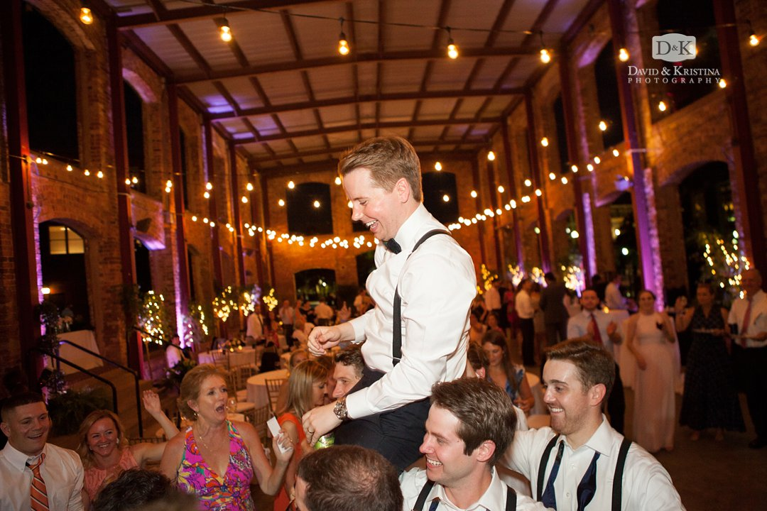 Groom being carried on a chair