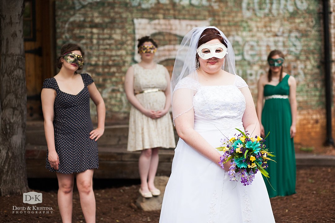 bride and bridesmaids in mardi gras masks
