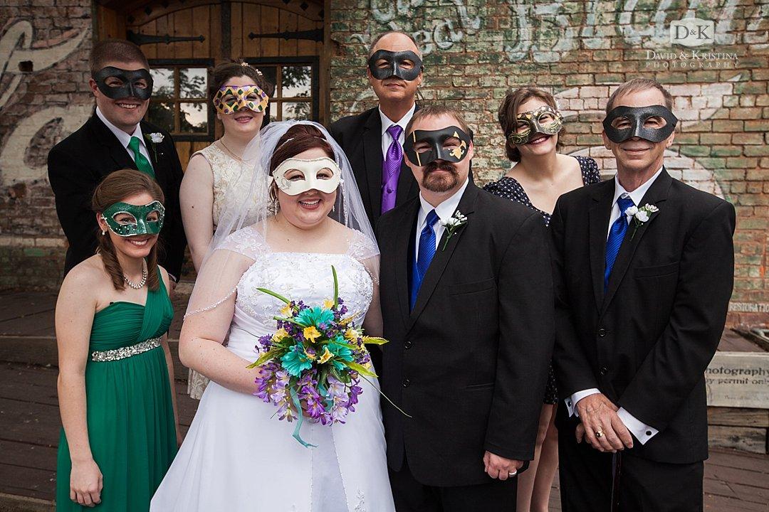 wedding party wearing Mardi Gras masks
