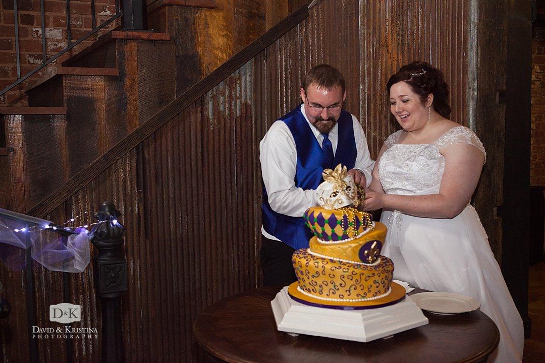 cutting mardi gras wedding cake