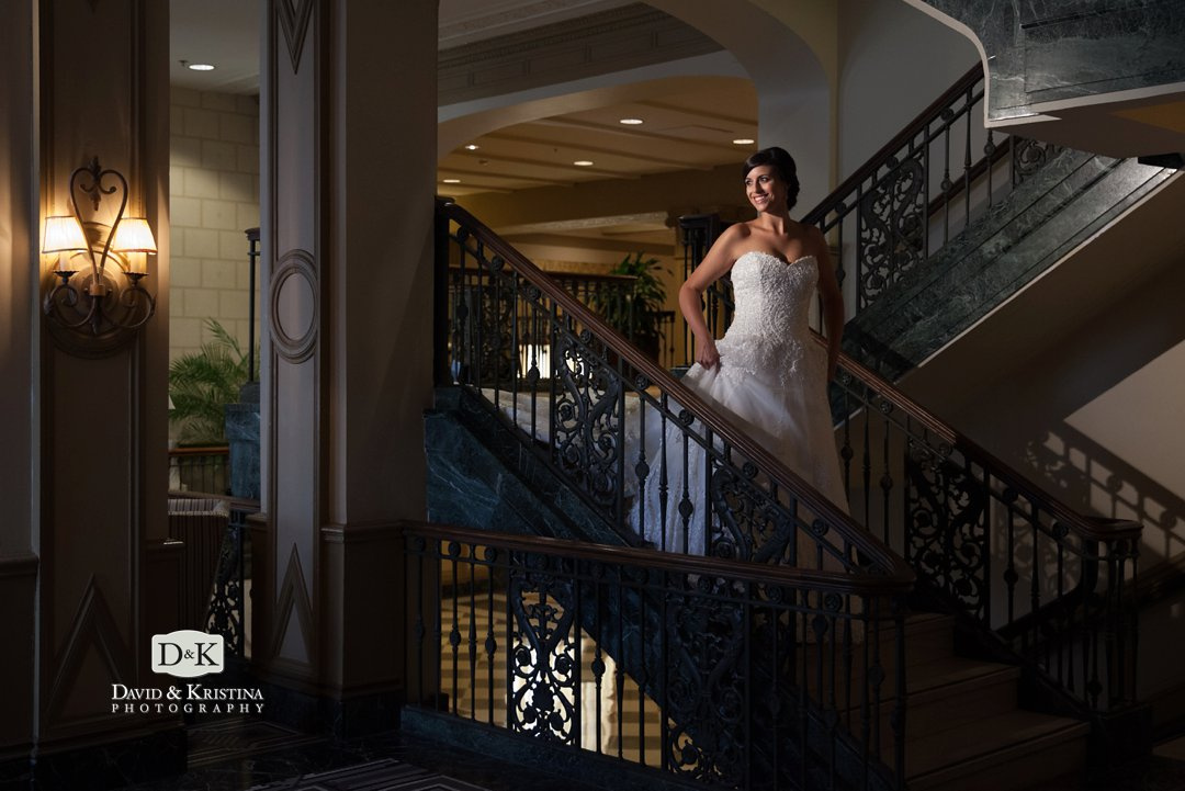 bridal portrait on stairway to Veranda of Westin Poinsett