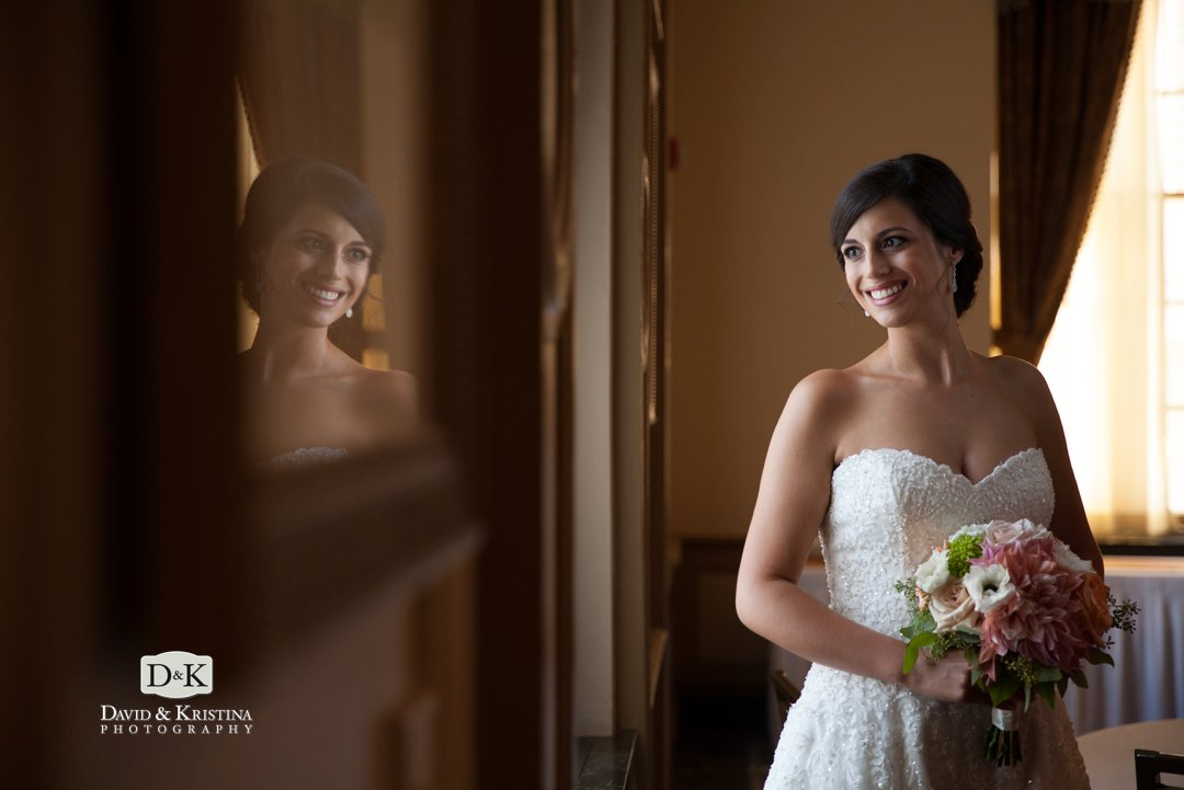 Bride's reflection in picture frame at Westin Poinsett