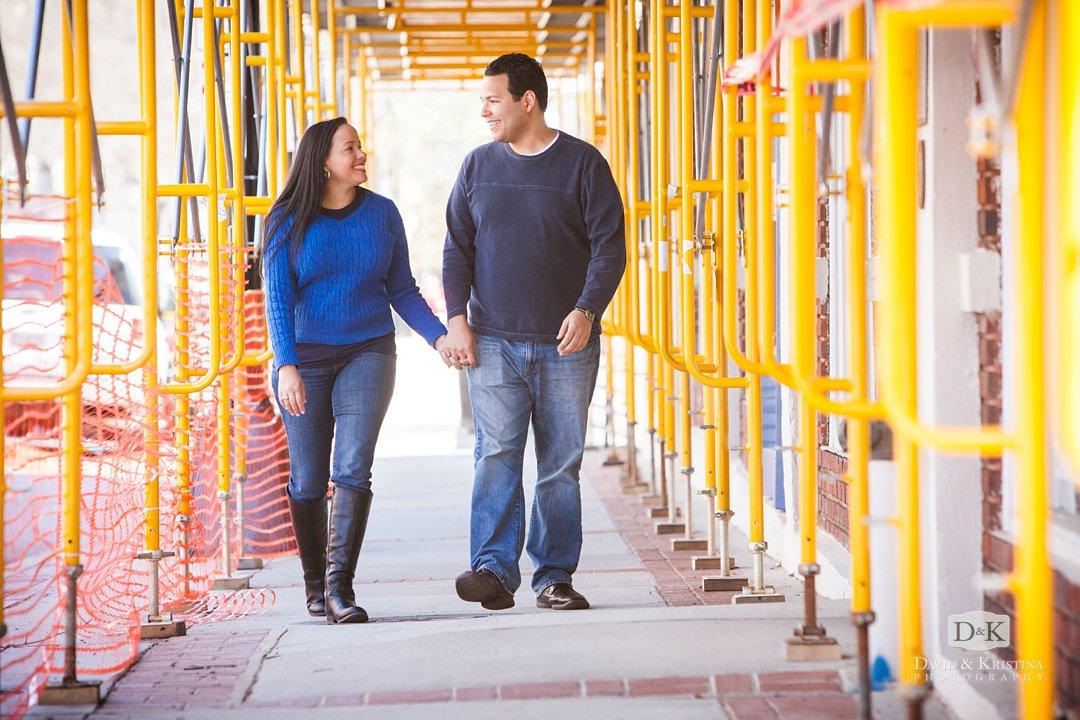 Urban engagement photos under scaffolding Greenville SC