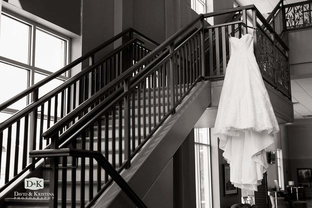 Bride's dress hanging on stairway