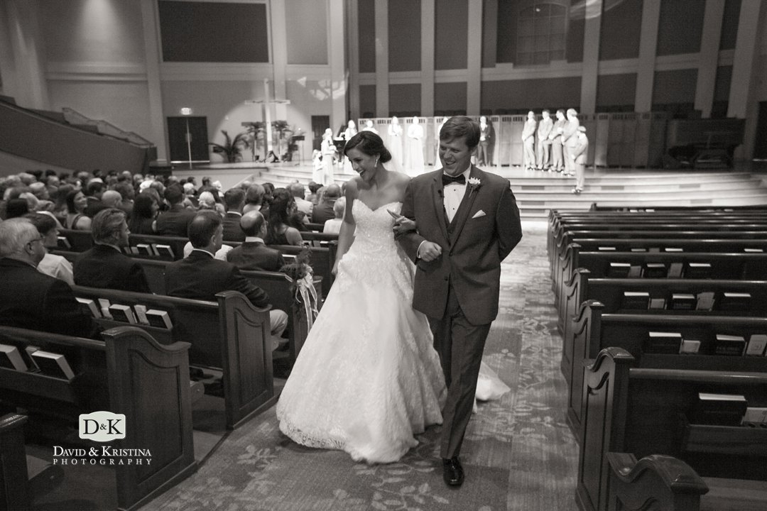 bride and groom walking up the aisle after simpsonville first baptist wedding
