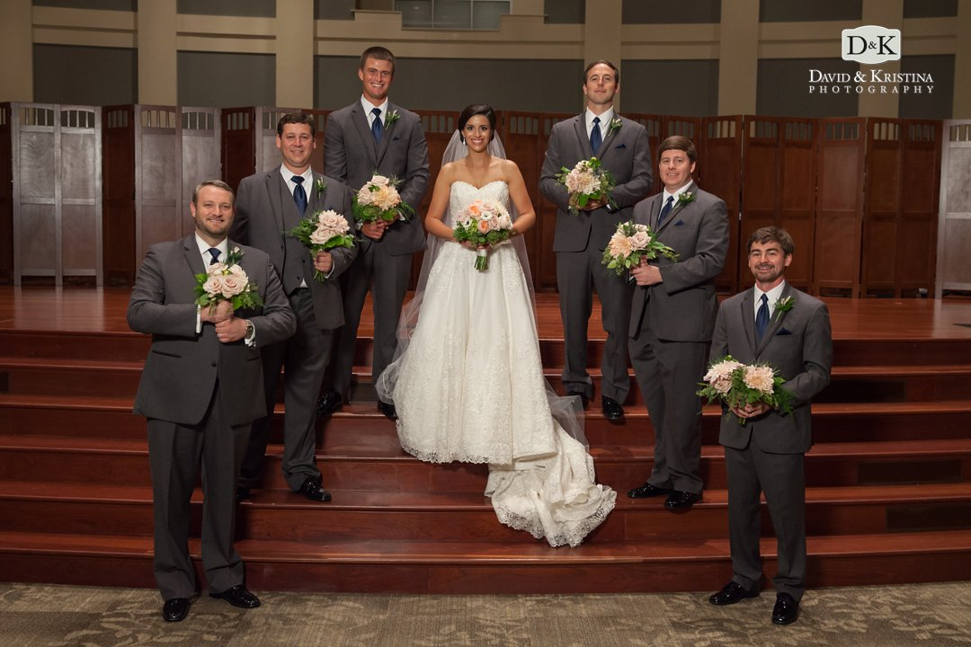 groomsmen holding bouquets