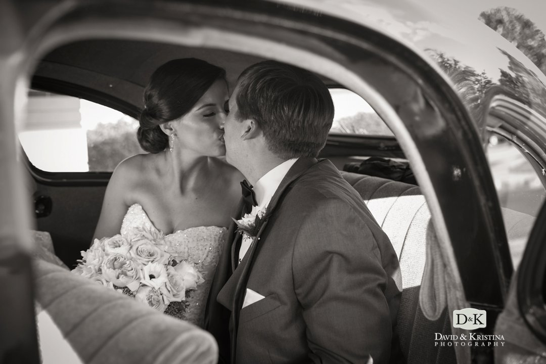 bride and groom in old classic car
