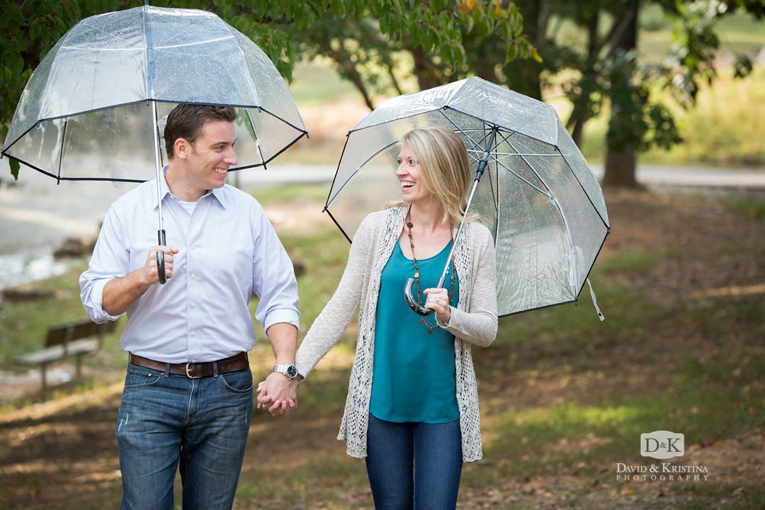 Clear umbrellas for engagement photo shoot