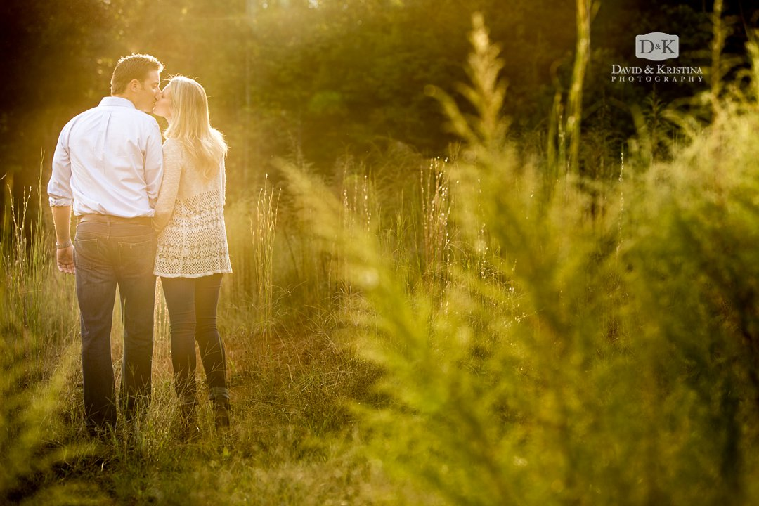 Engagement photos at sunset in a field of wheat