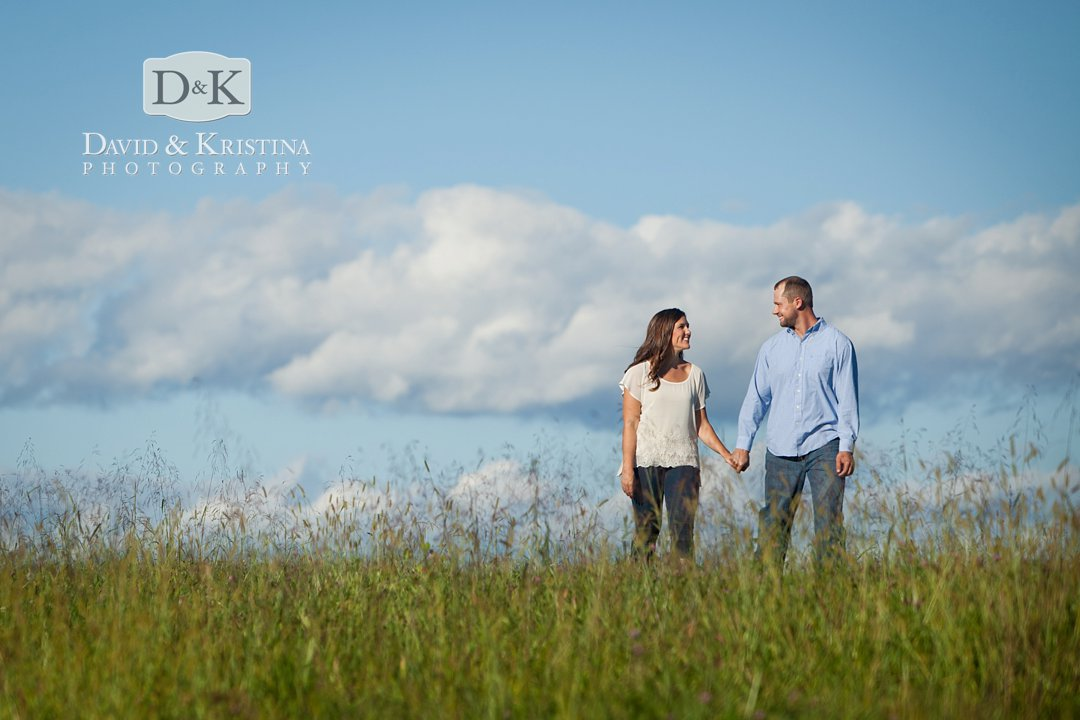 michael and kelsey walking through a field at Chattooga Belle Farm