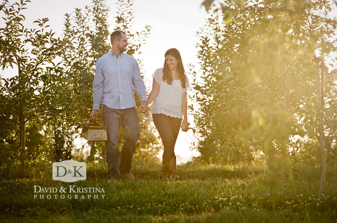 couple in Chattooga Belle Farm apple orchard shot on film