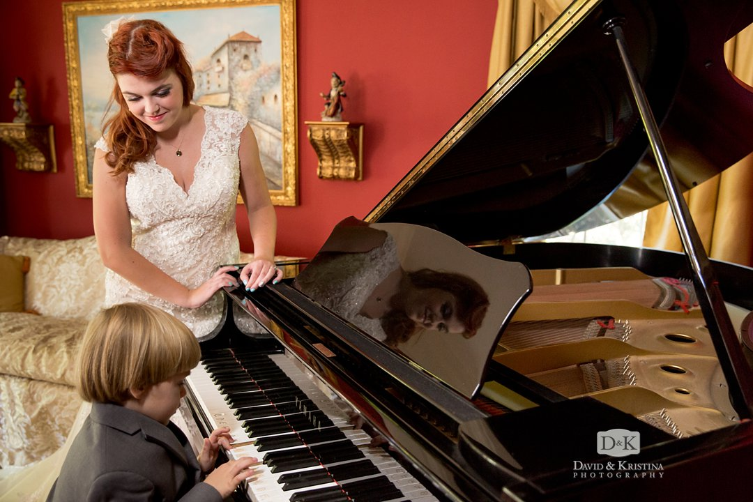 Amanda watching son play piano