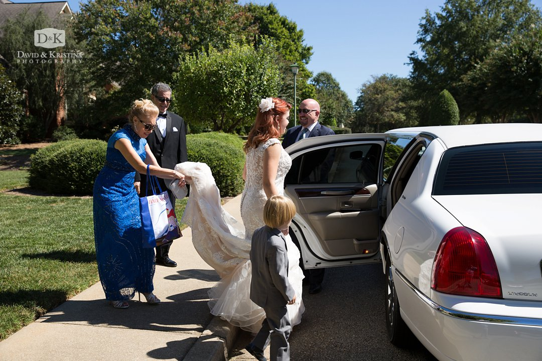 bride getting in limo before wedding