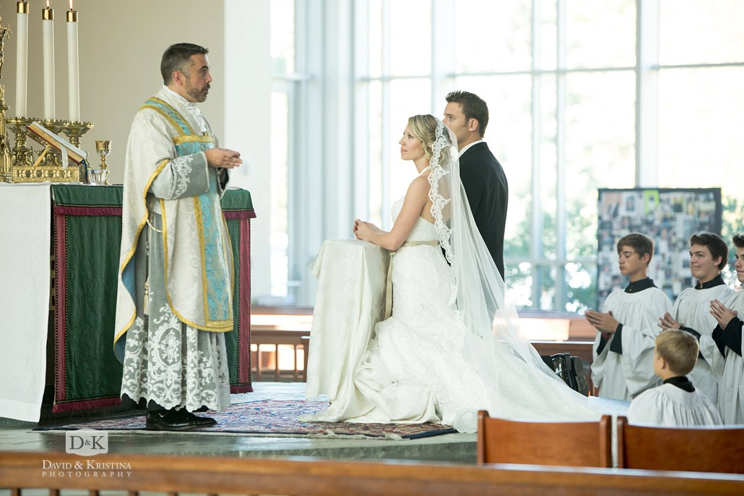 bride and groom at altar of Catholic wedding at Prince of Peace