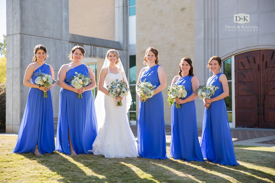 Chelsea with bridesmaids in blue dresses