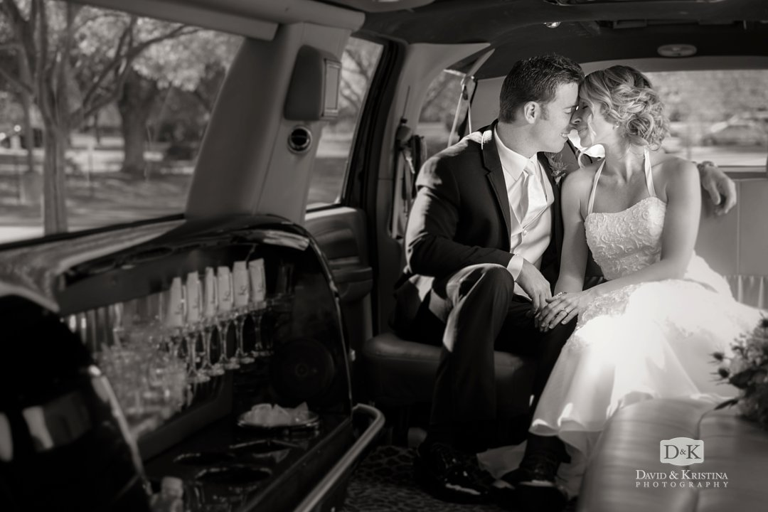 bride and groom in limo leaving wedding