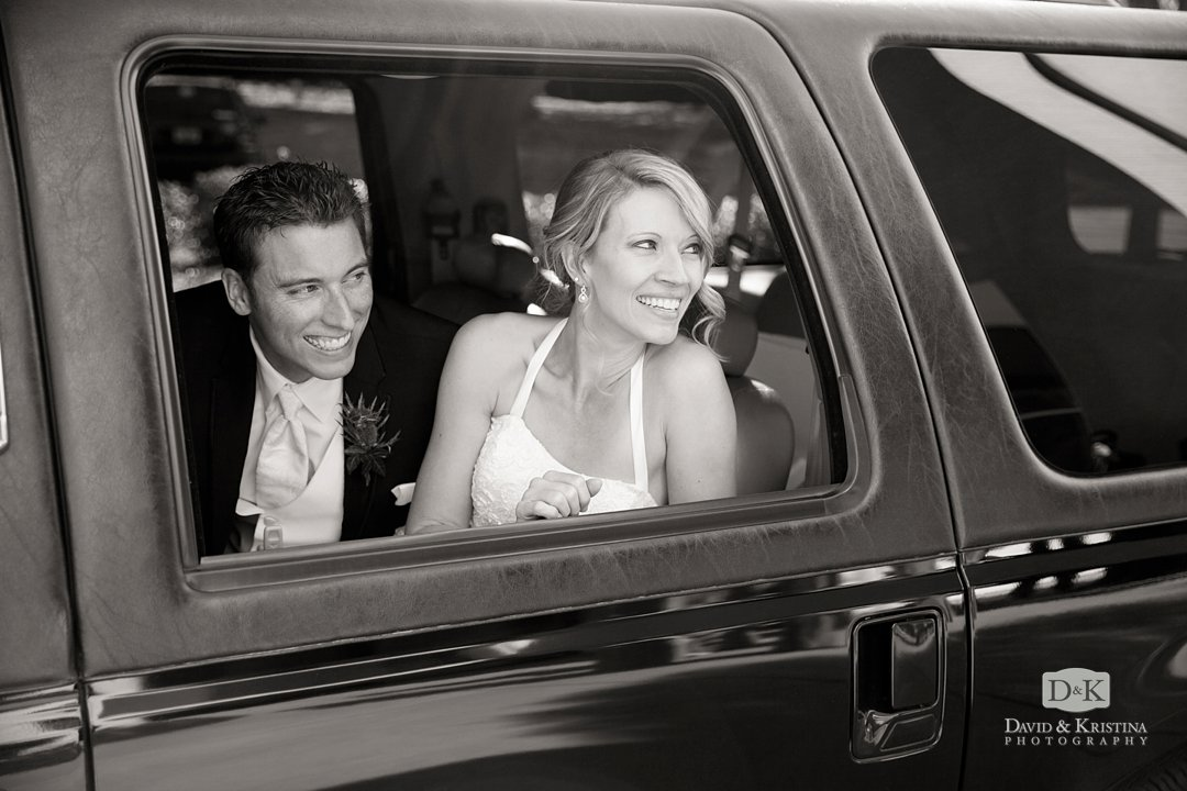 Ryan and Chelsea waving goodbye from limo window