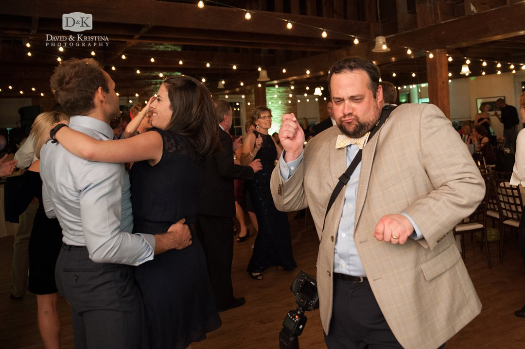 David dancing while photographing wedding
