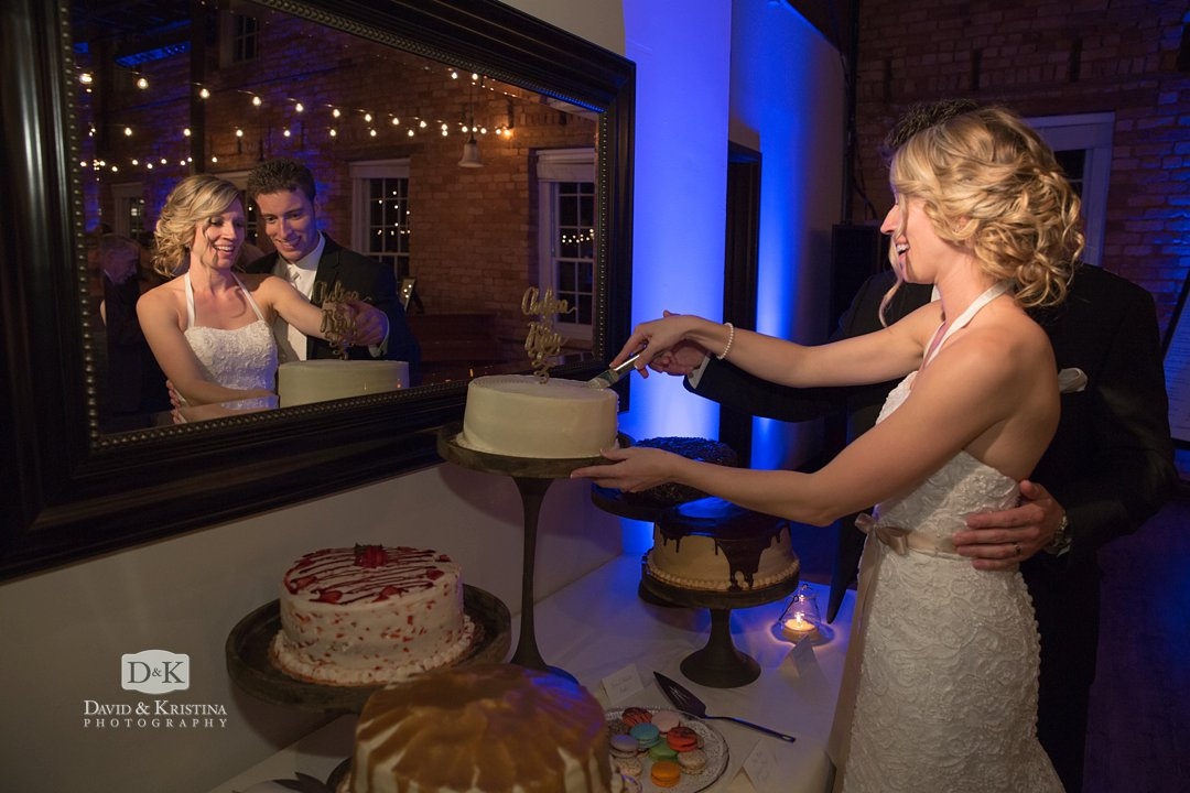 cutting cake in Larkins Cabaret Room wedding reception