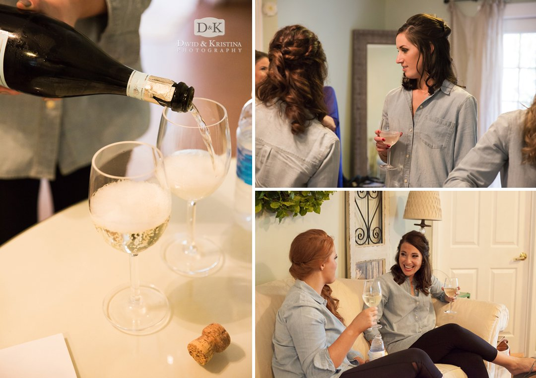 pouring champagne in bridal suite