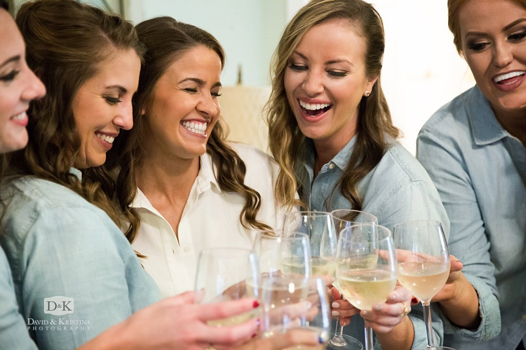 bridesmaids in chambray shirts drinking champagne