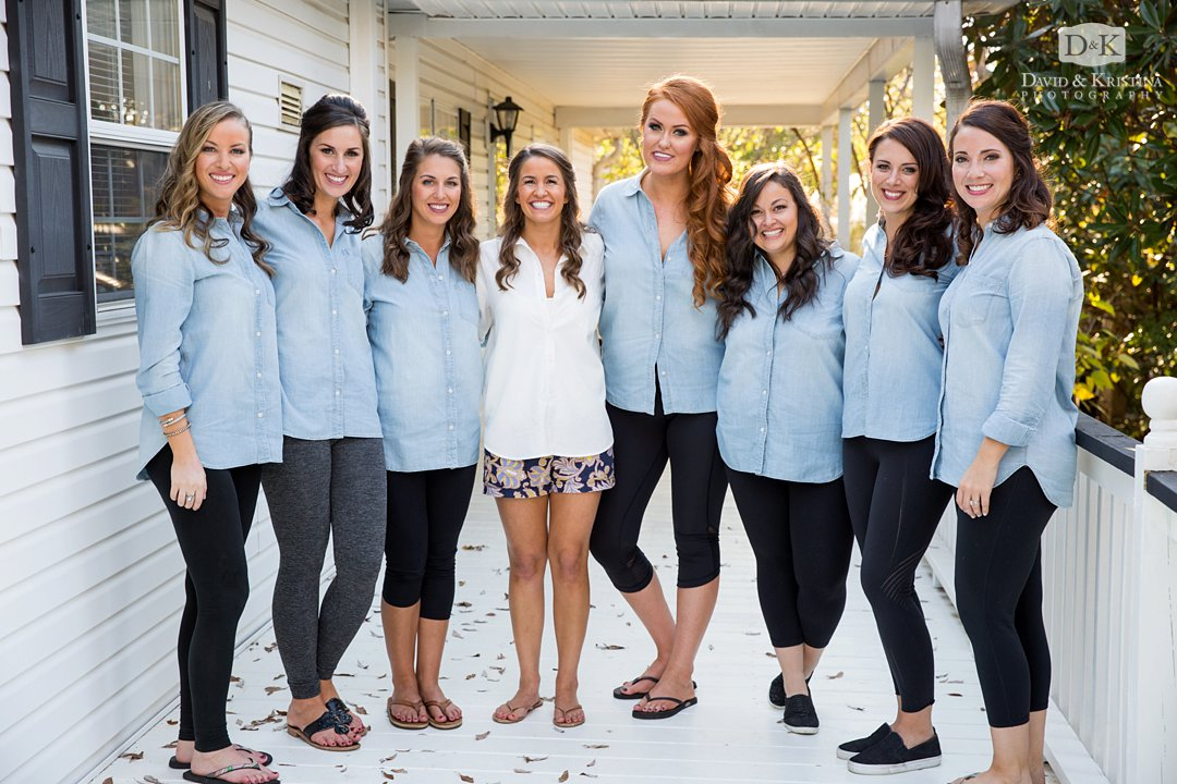 bride and bridesmaids in blue chambray shirts