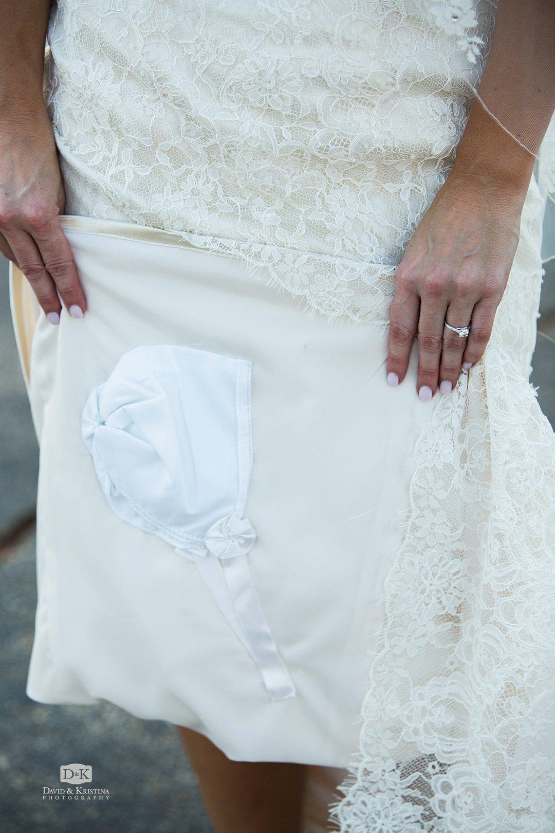 groom's baby bonnet sewn into bride's dress