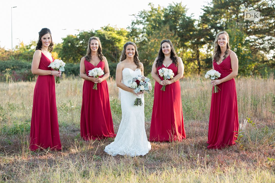 bride with bridesmaids in field