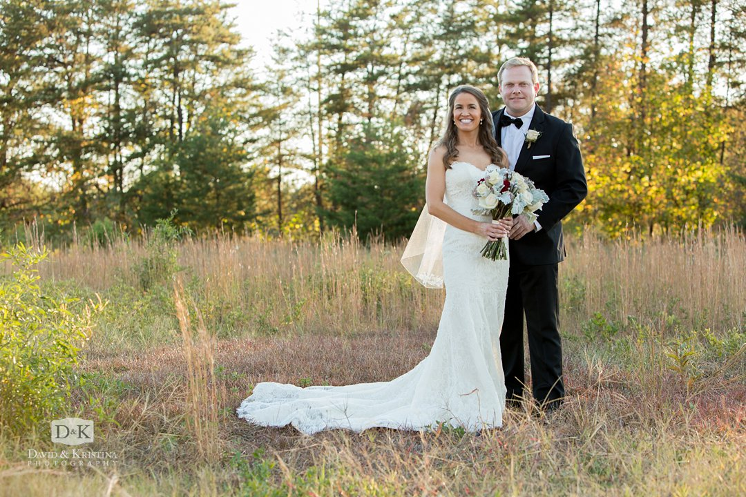 Twigs field wedding photo of bride and groom
