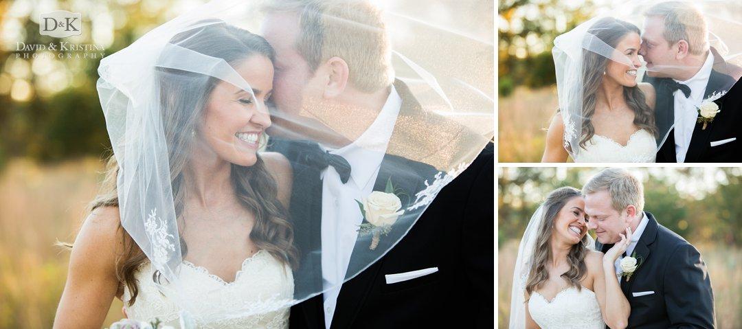 bride and groom behind veil