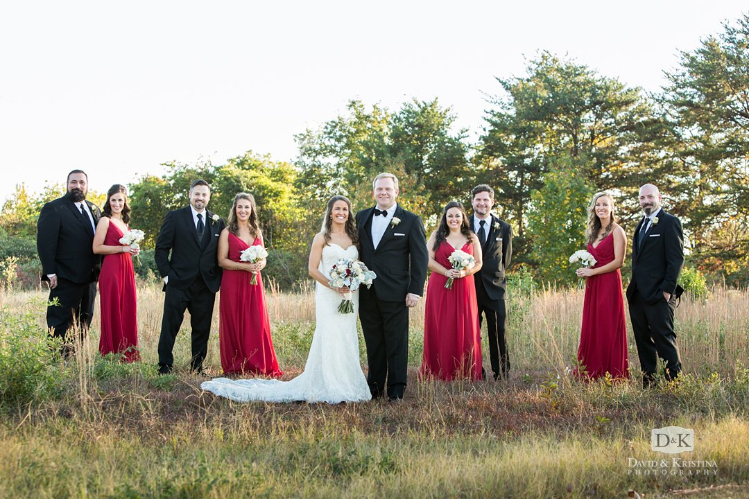 wedding party in a field at sunset
