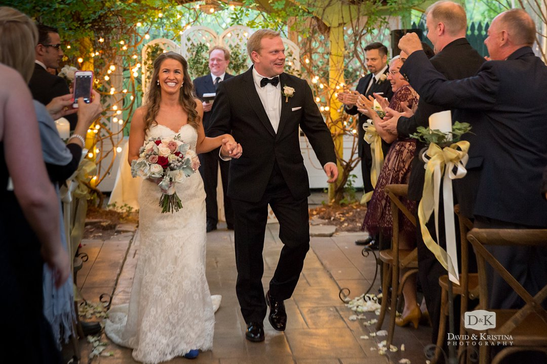 Trevor and Kim walking up aisle after wedding at Twigs