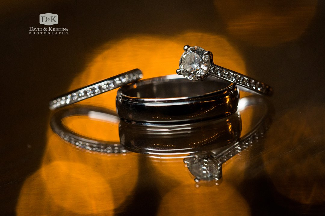 wedding rings on reflective glass