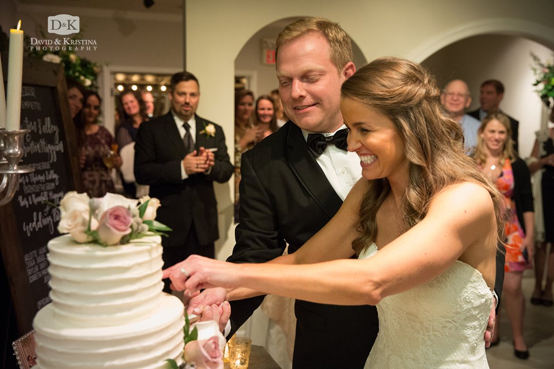 Kim and Trevor cutting wedding cake by Amanee Neirouz